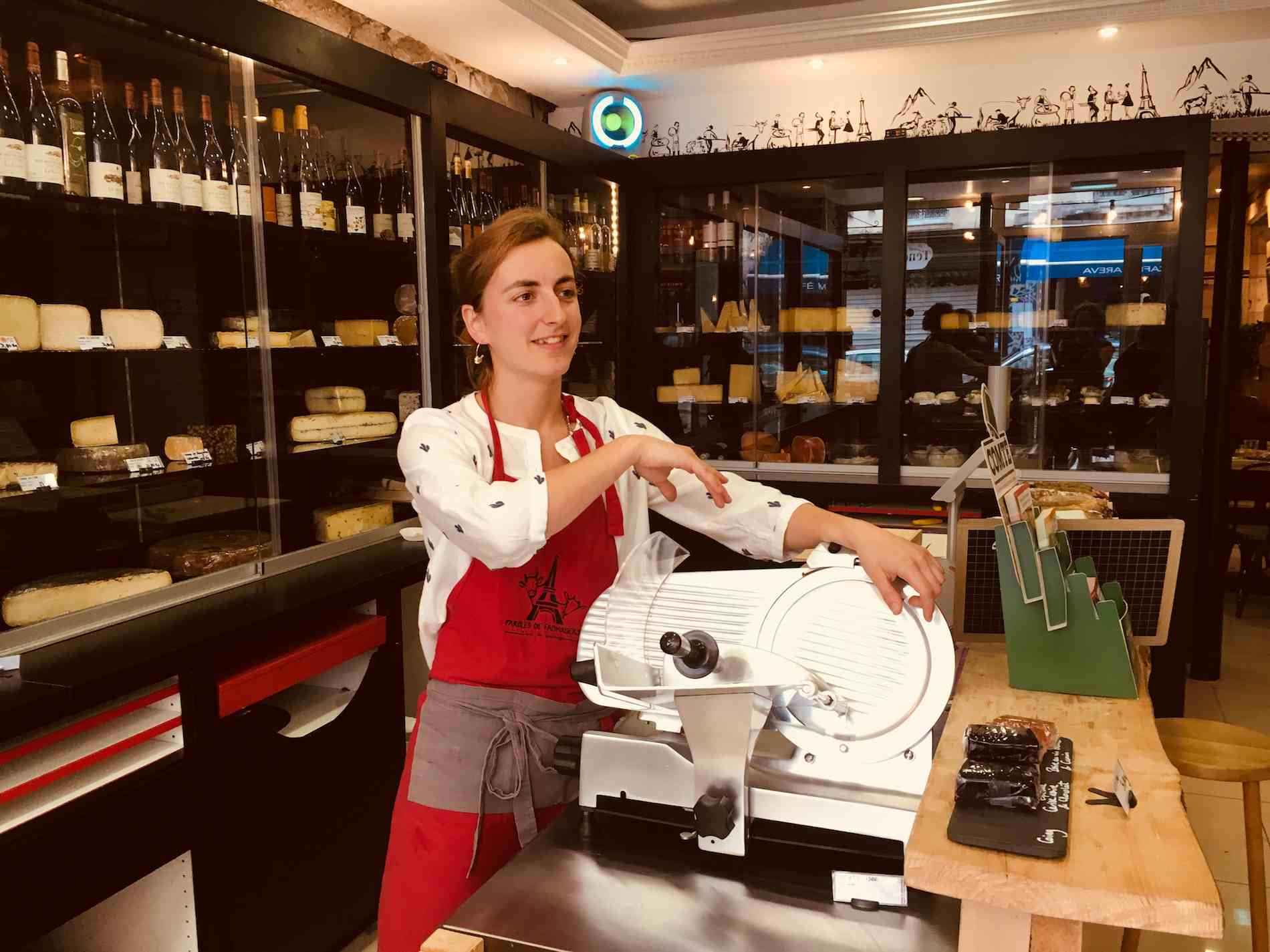 Caroline de Seze, co-owner of Paroles de Fromagers in Paris, demonstrates at the main shop in Belleville.