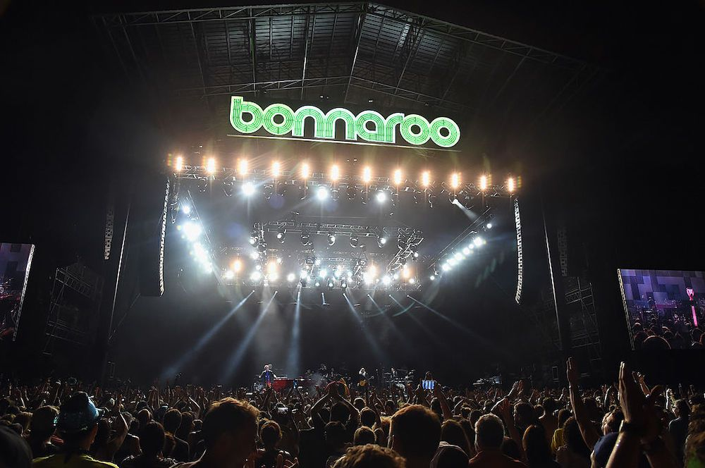 Crowd in from of a lit stage at Bonnaroo music festival, Nashville