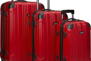 three sizes of red kenneth cole luggage on white background