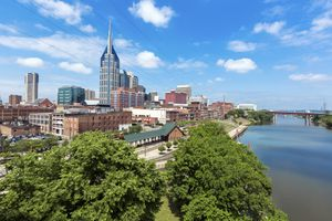 City street in Nashville Tennessee showing the skyline and train station