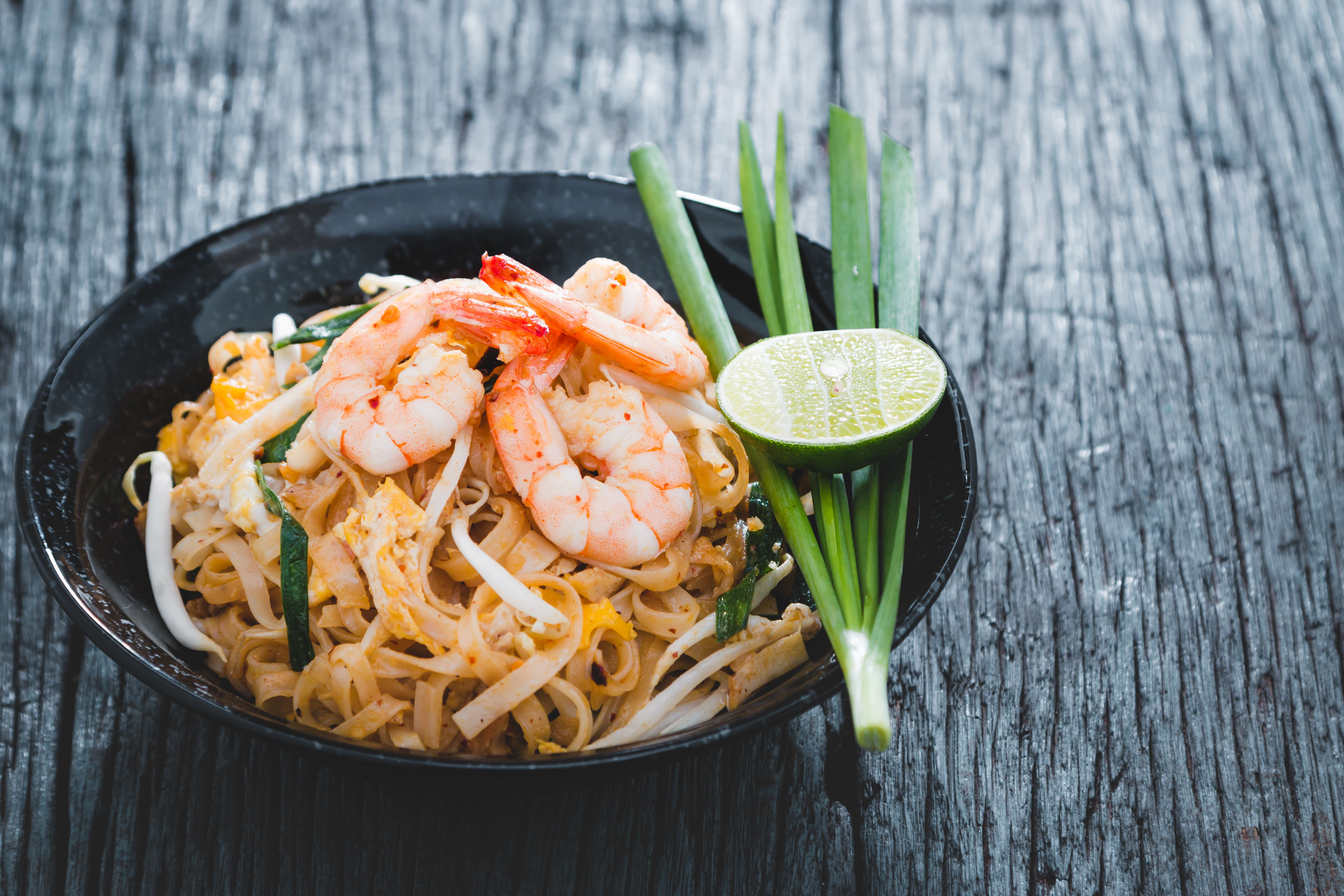 A bowl of pad thai shrimp