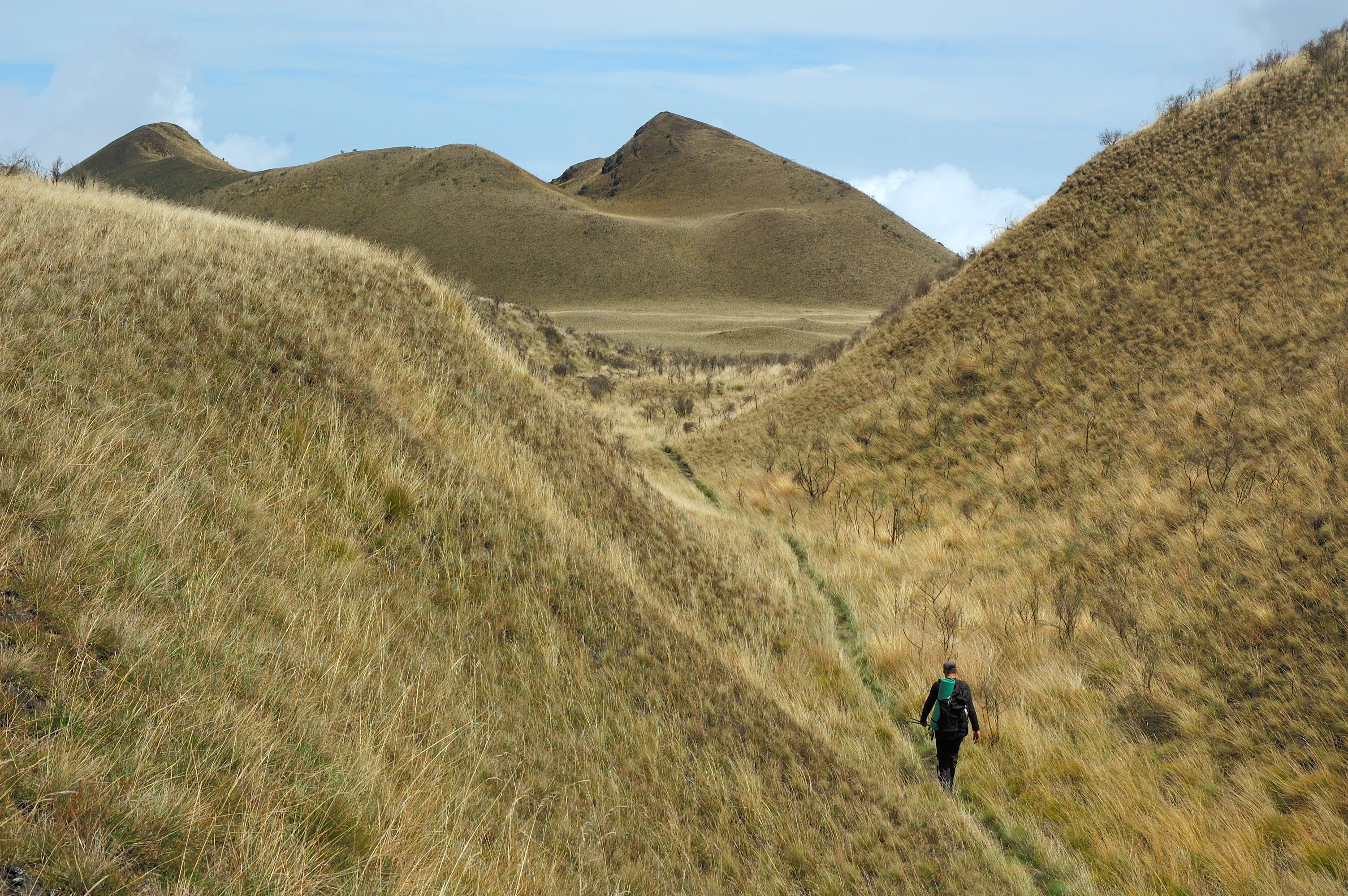 Hiker near volcano crater