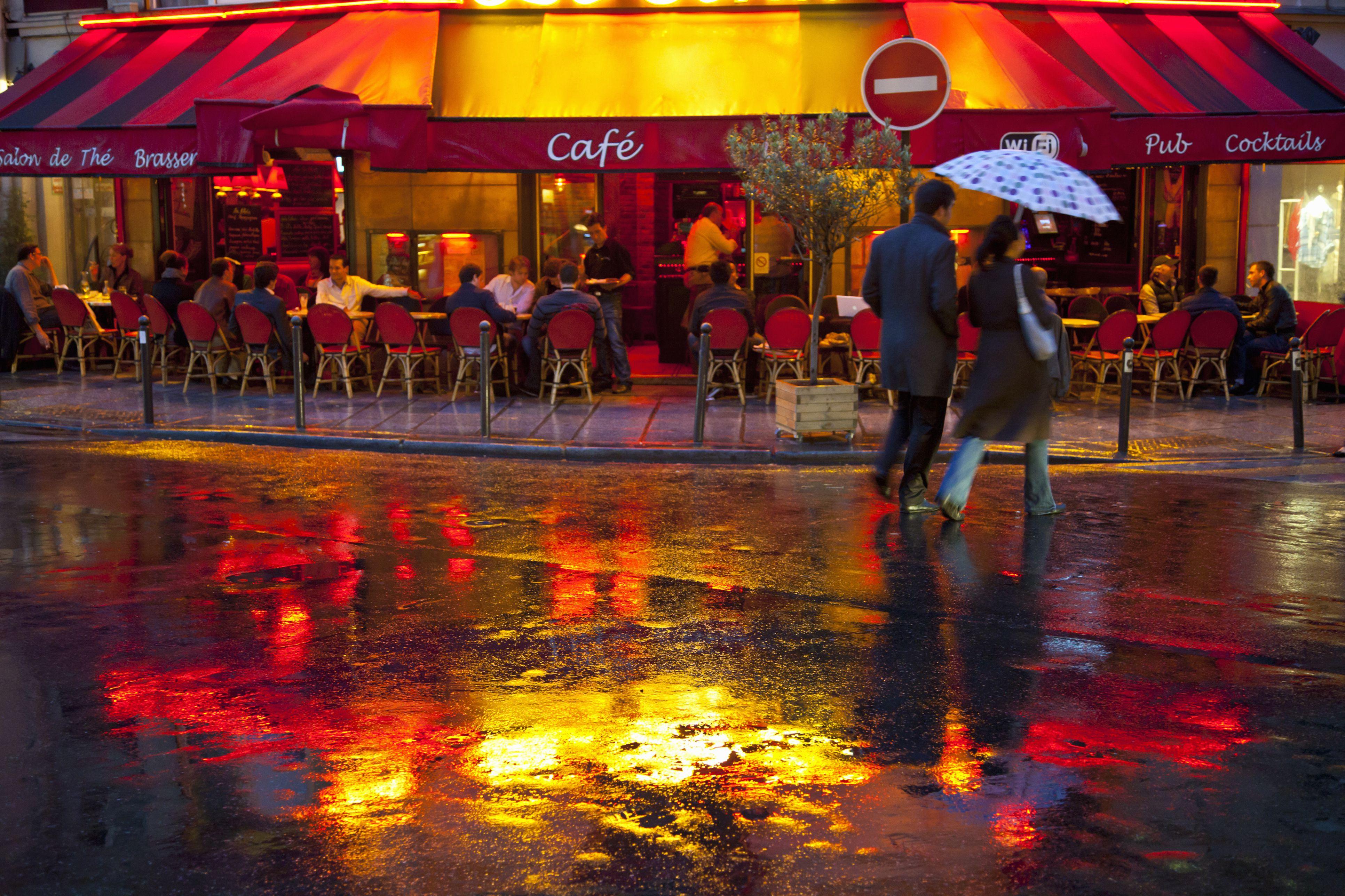 Cafe scene with couple in rain, Paris