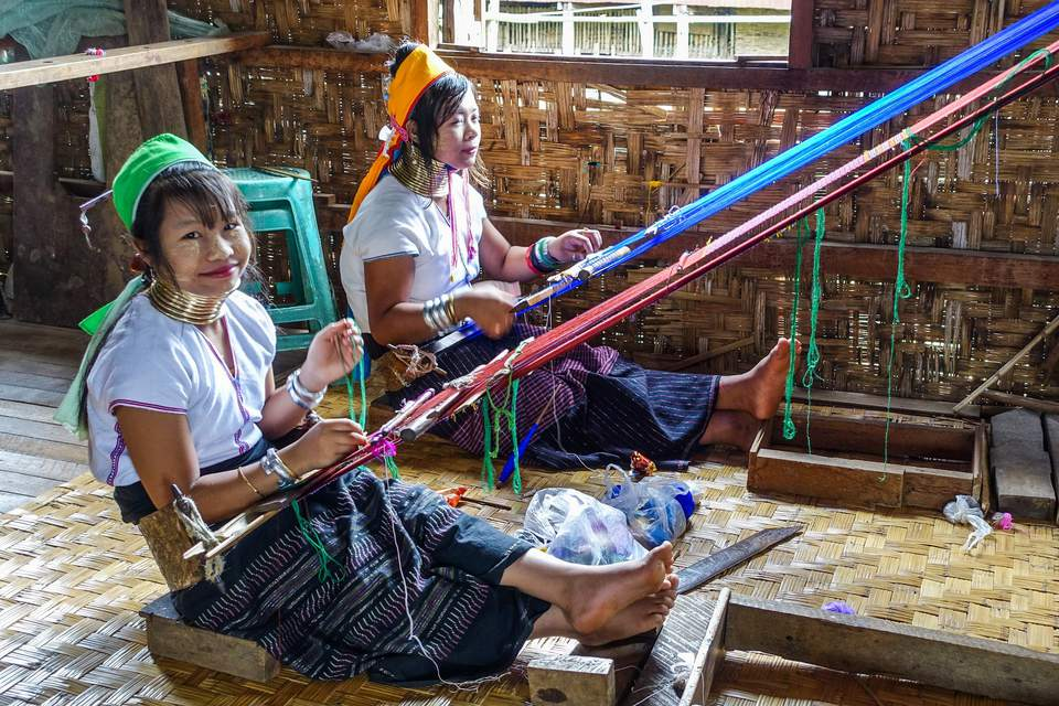 Padaung girl weaving at Inle Lake, Myanmar