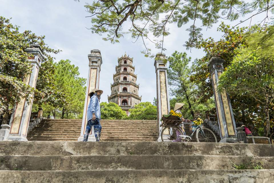 Locals in front of Thien Mu Pagoda, Hue, Vietnam
