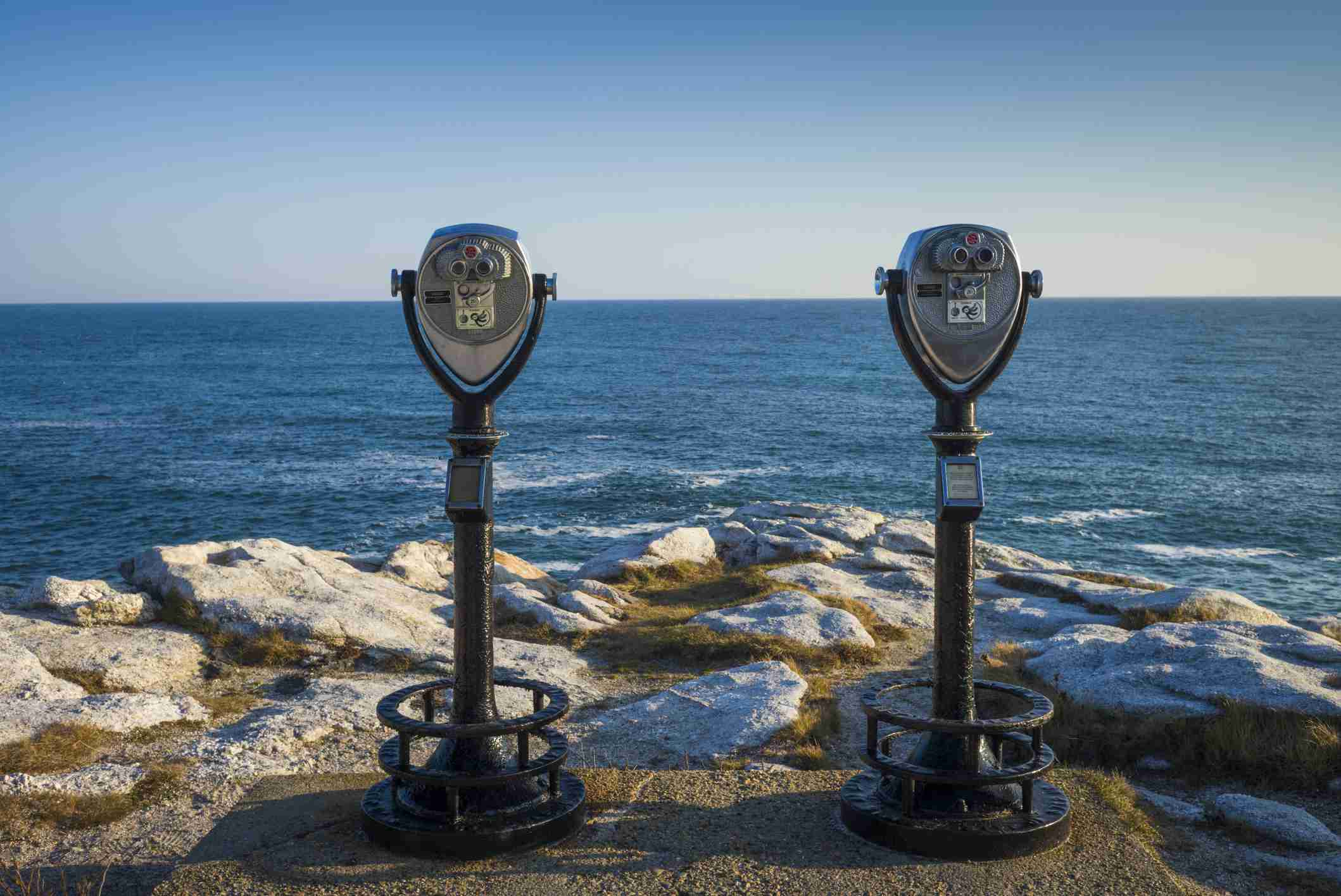 USA, North America, Maine, Reid State Park, Coin operated binoculars against sea
