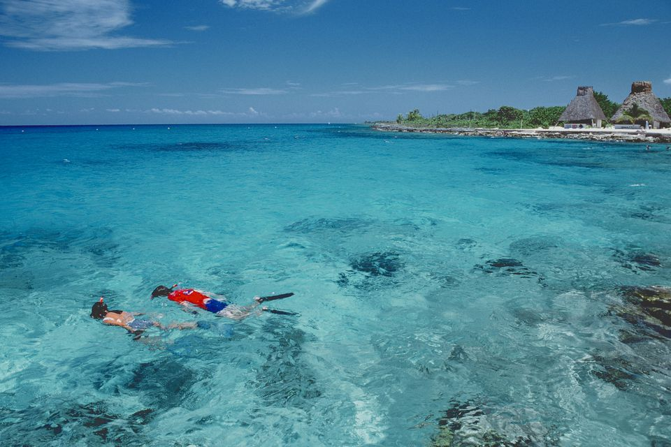 Couple snorkeling off a beach of Cozumel Island.
