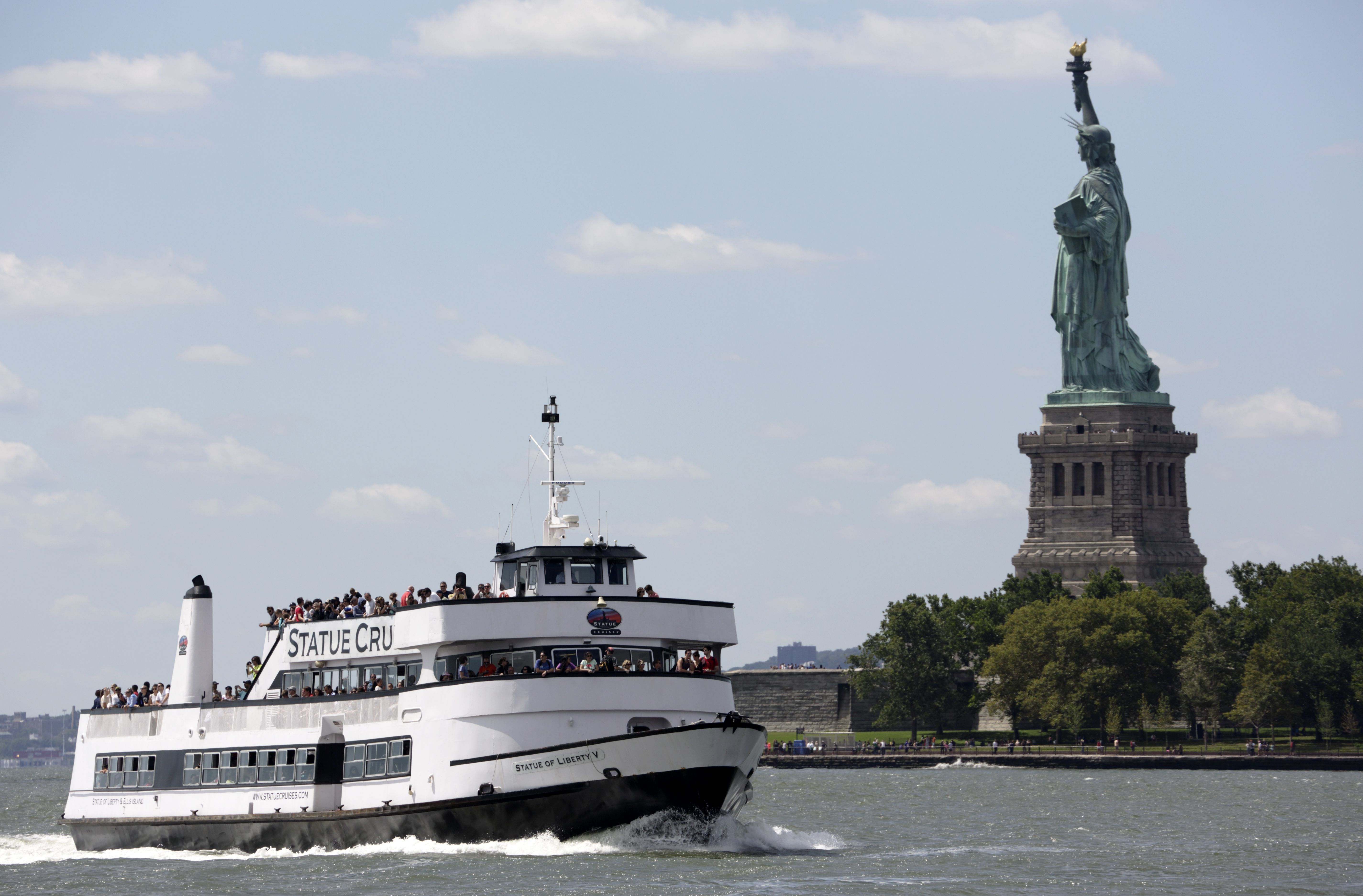 Statues of liberty and cruise ship