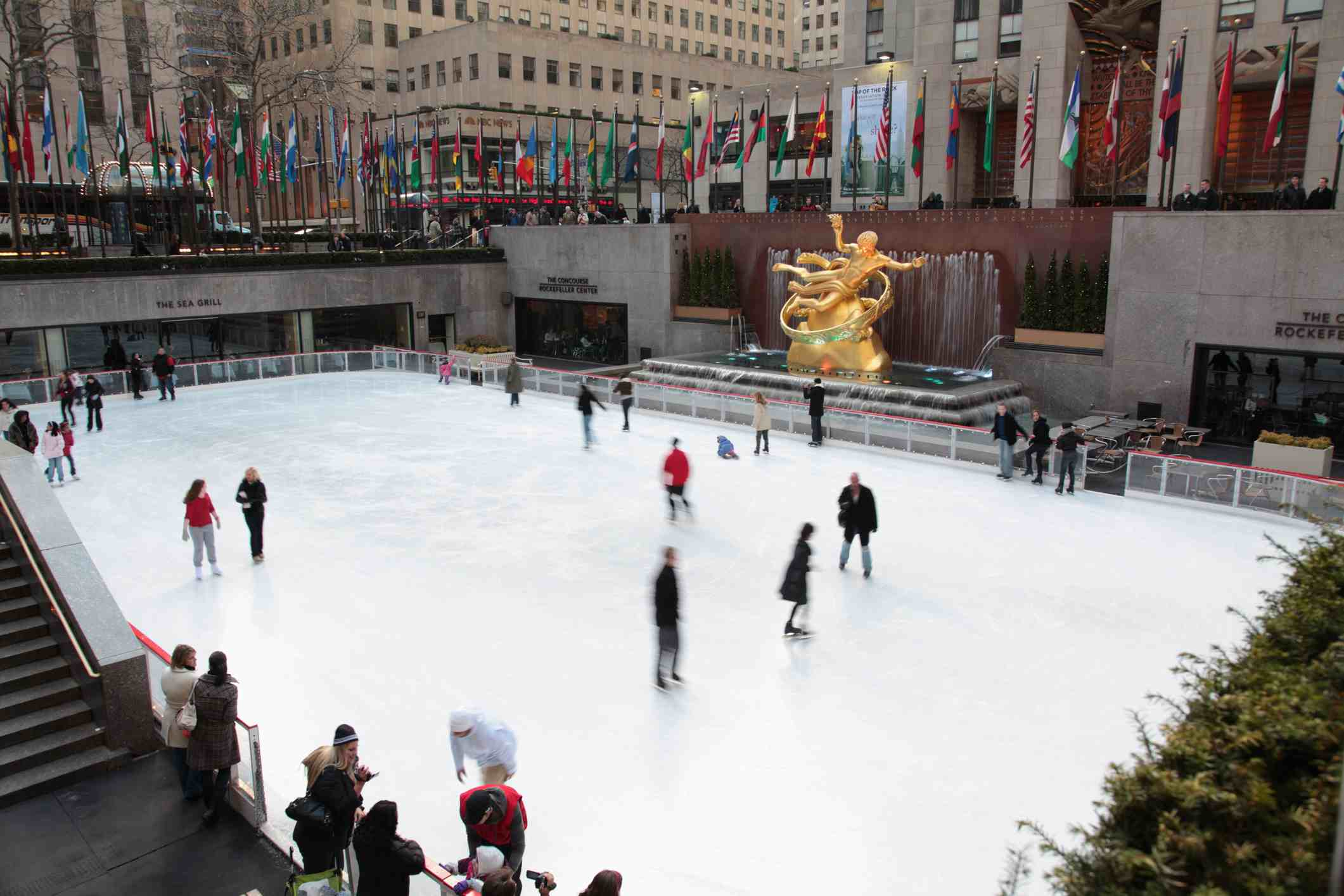 Ice skating rink at the Rockefeller Center with the statue of Prometheus in the back, New York City, New York State, USA