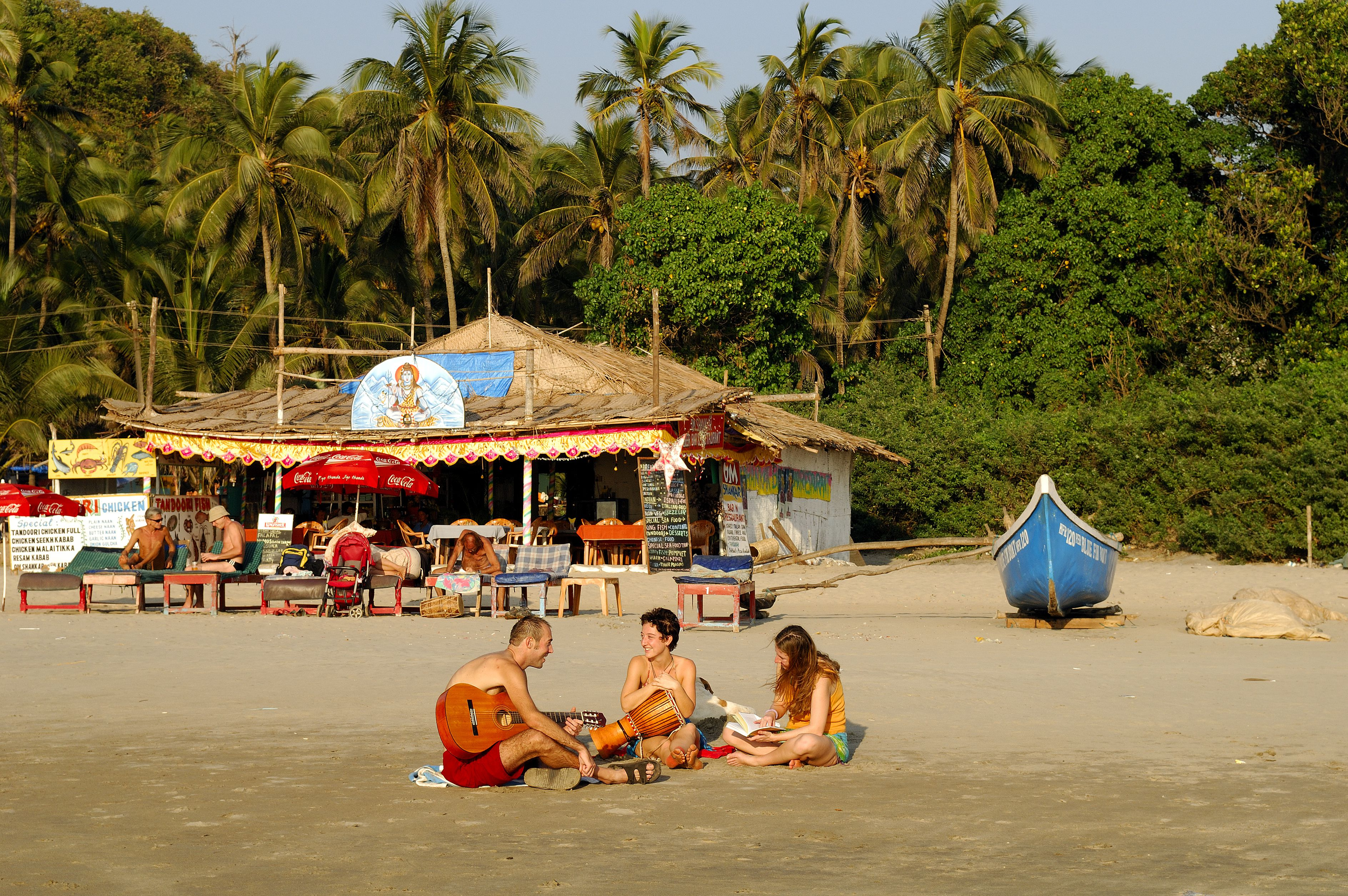 Tourists on a beach in Goa.