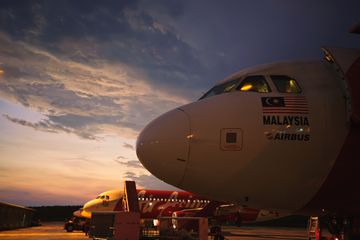 AirAsia planes at sunrise, Kuala Lumpur airport, Malaysia