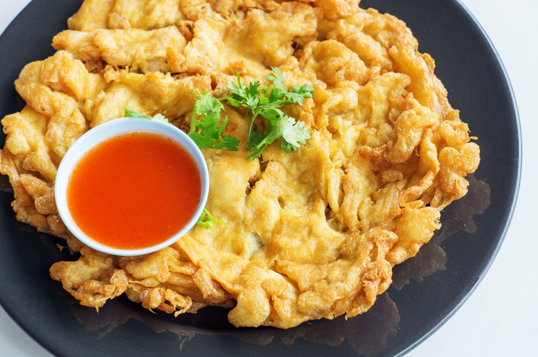 Kai jeow, a Thai-style omelete with spicy sauce