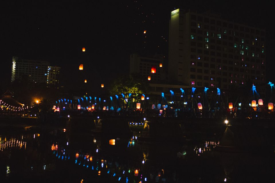 People releasing lanterns on the Ping River for Loy Krathong