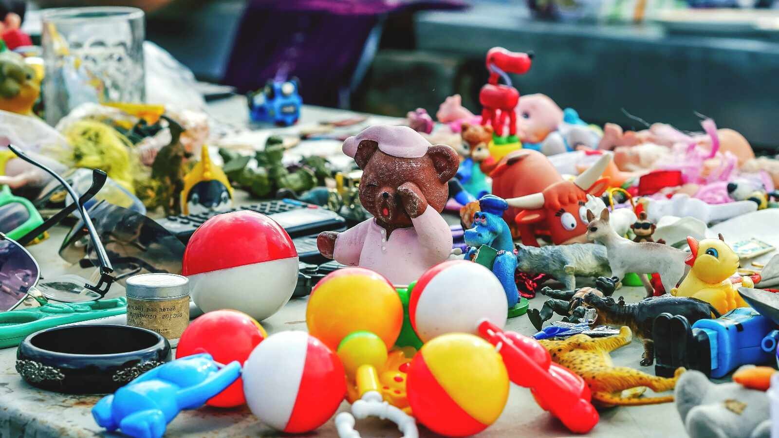 Close-Up Of Multi Colored Toys For Sale In Russian Market