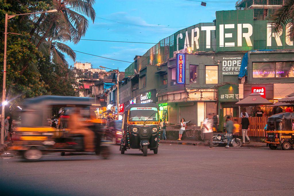 Small tuktuks speeding by on carter Road