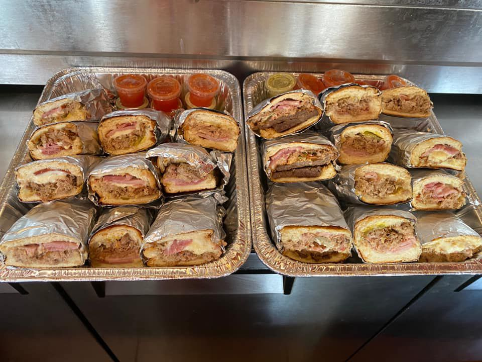 A tray filled with cuban sandwiches