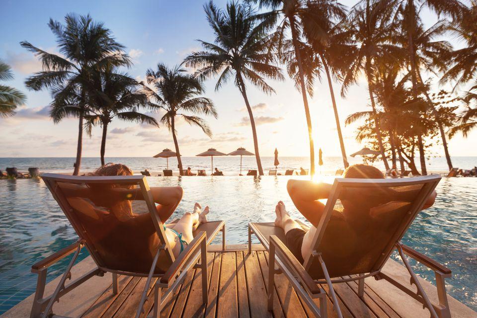 luxury travel, romantic couple in beach hotel