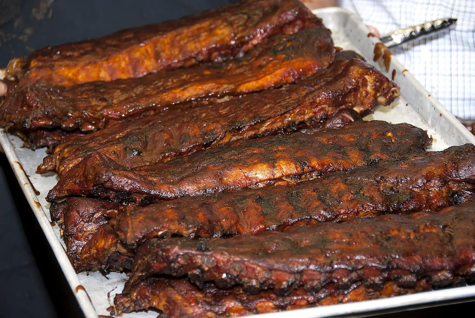 Tray of Kansas city-style barbecue whole pork barbecued spare ribs.