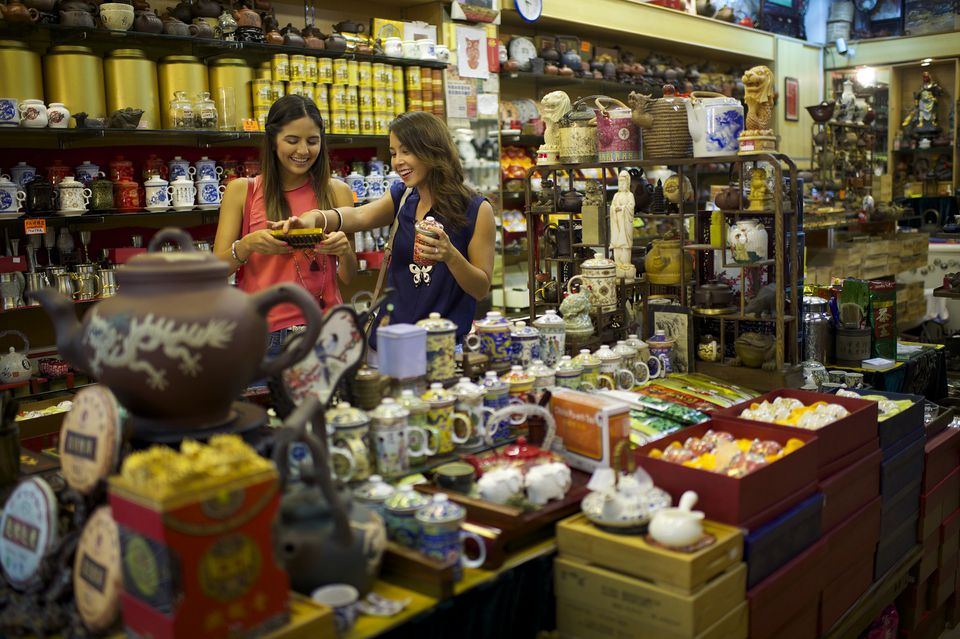 Shoppers in traditional Chinese medicine store, Chinatown, Singapore