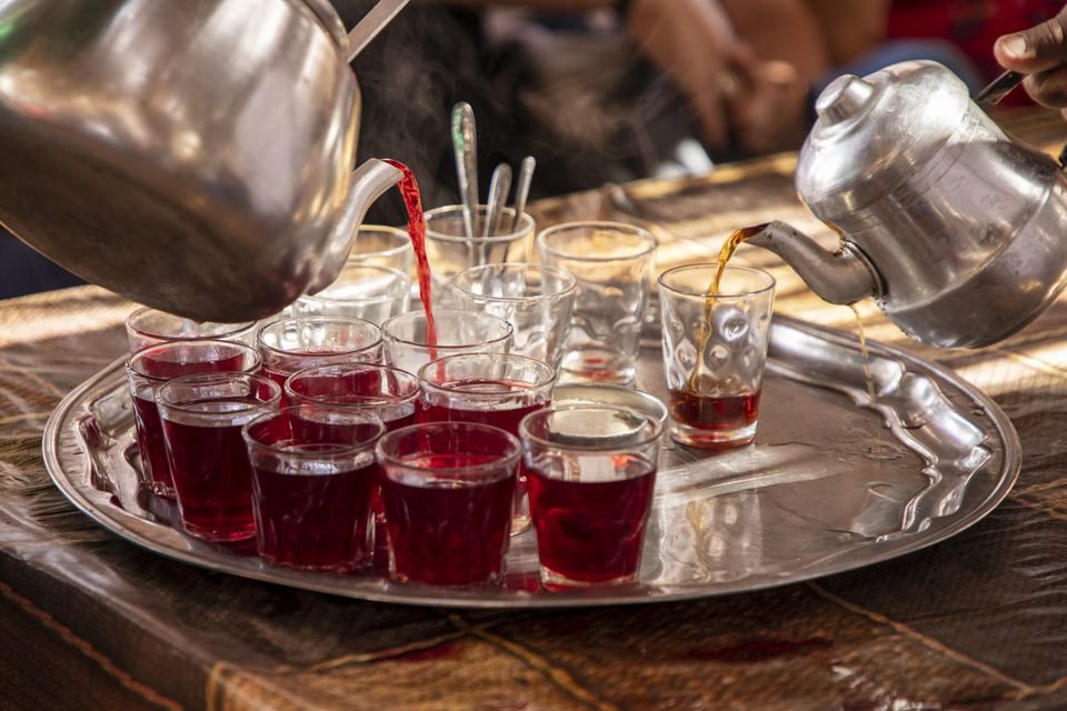 Serving hibiscus tea, Egypt