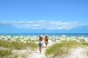 Beach chairs and umbrellas on beautiful white sand and ocean in the background. Gulf of Mexico, Clearwater Beach, Florida, USA