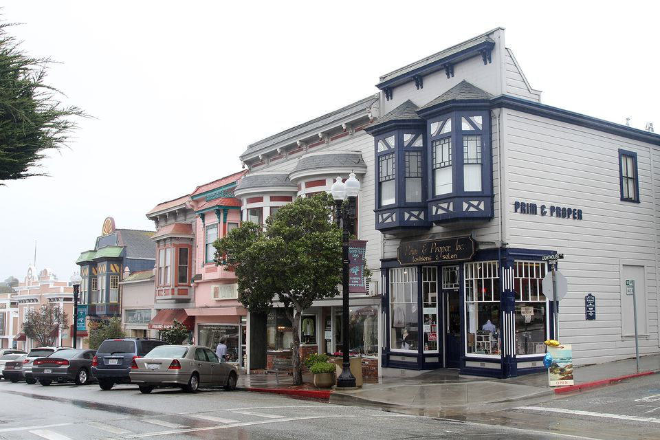 The main shopping street in Pacific Grove from the corner of Lighthouse and Grand Avenues. Pacific Grove, Monterey, California, USA.