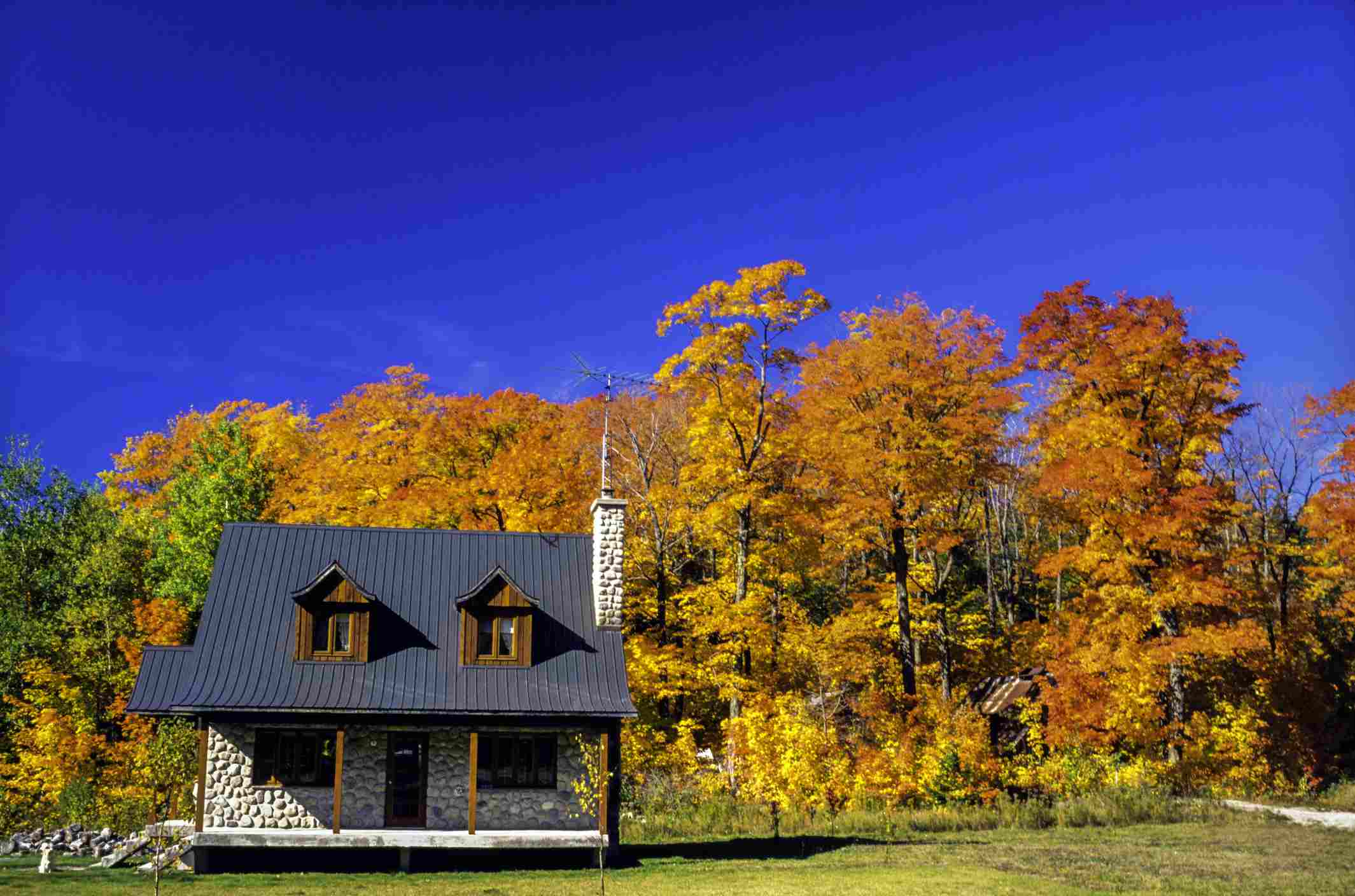 Little Stone cabin in the Laurentian forest in autumn (fall), Quebec - Canada