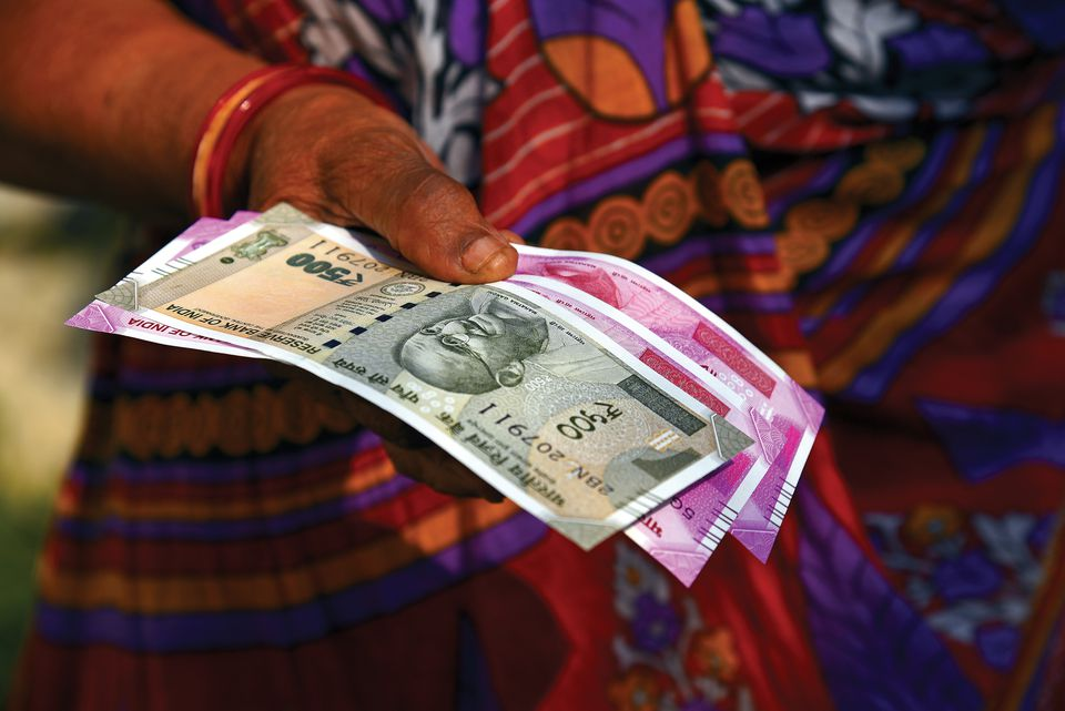 Women with new Rupees Notes in hand, India