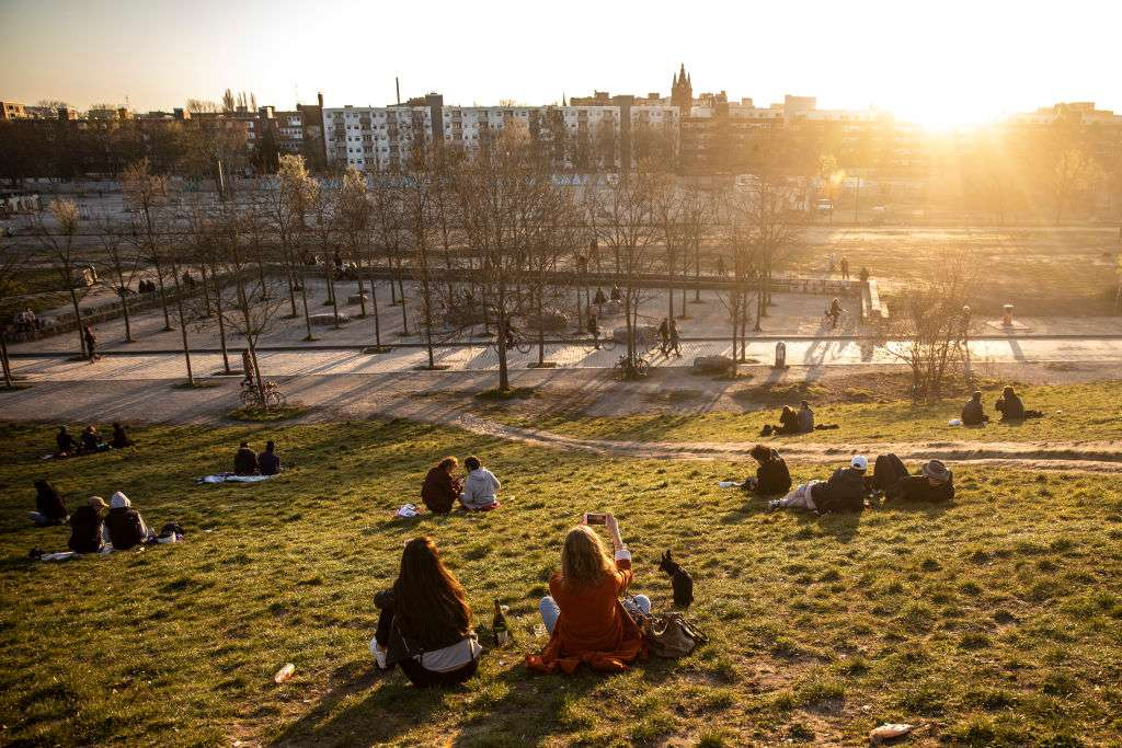 pairs of people sitting in Mauerpark, Berlin at sunset