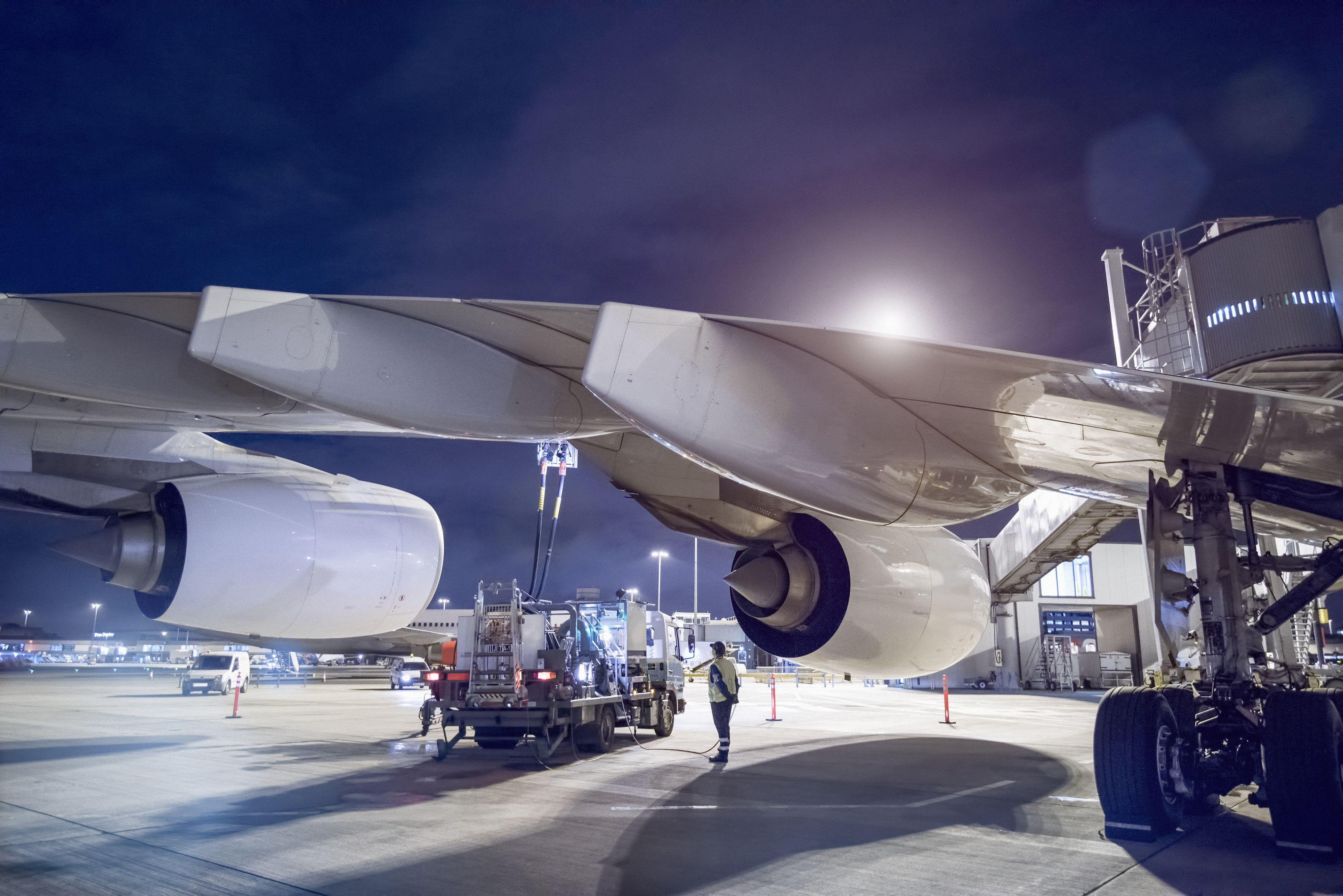 Ground crew refuelling A380 aircraft at airport
