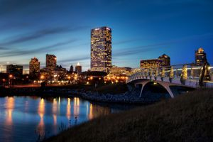 A twilight view of downtown Milwaukee, as seen from the pedestrian bridge at Lakeshore State Park Lagoon and Bridge