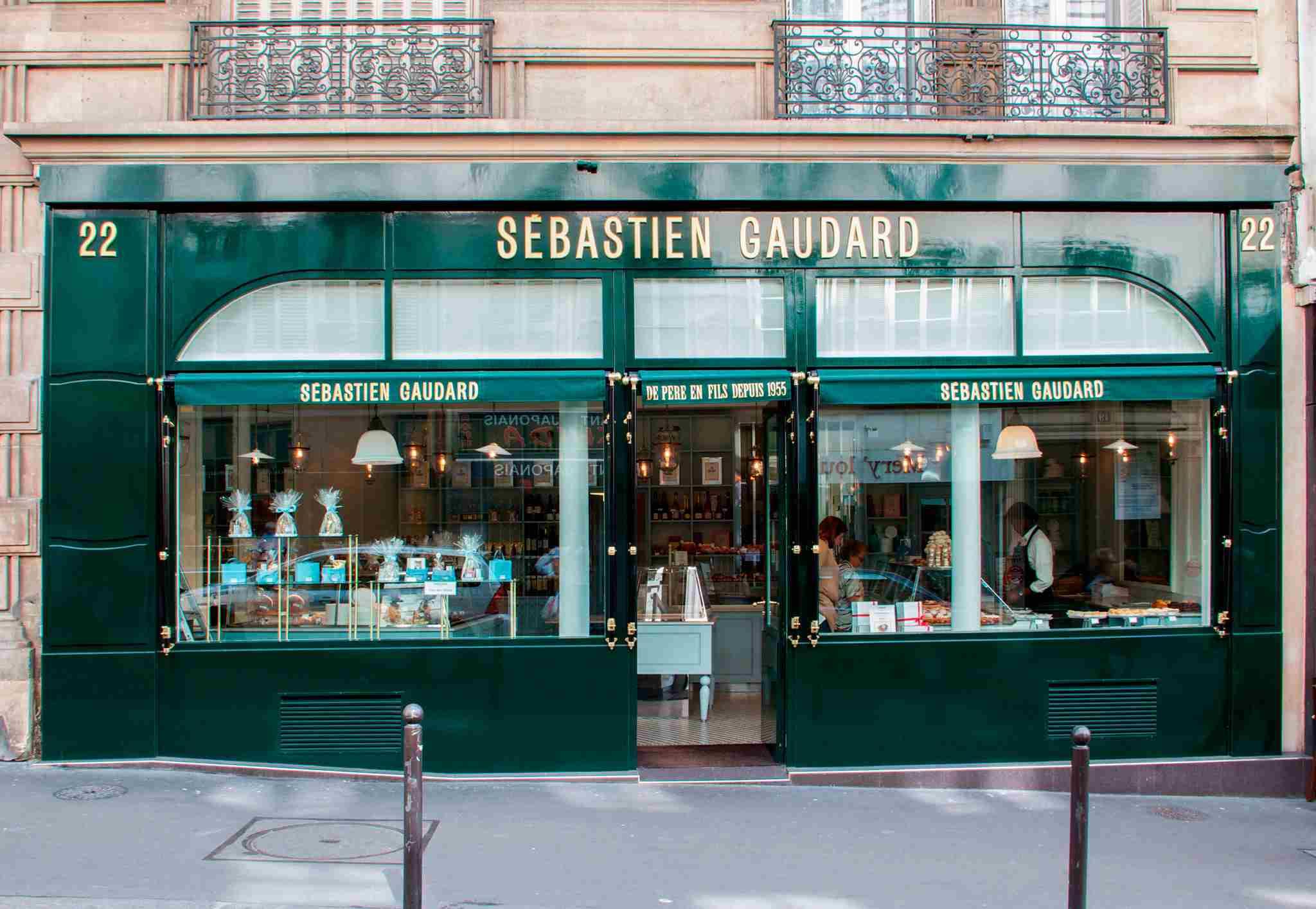 The elegant green exterior of Sebastien Gaudard's main bakery on rue des Martyrs.