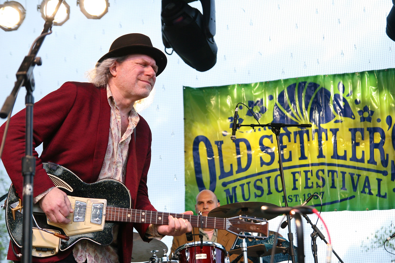 Performer singing at Old Settler's Music Festival