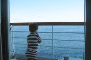 Little boy overlooking a cruise deck