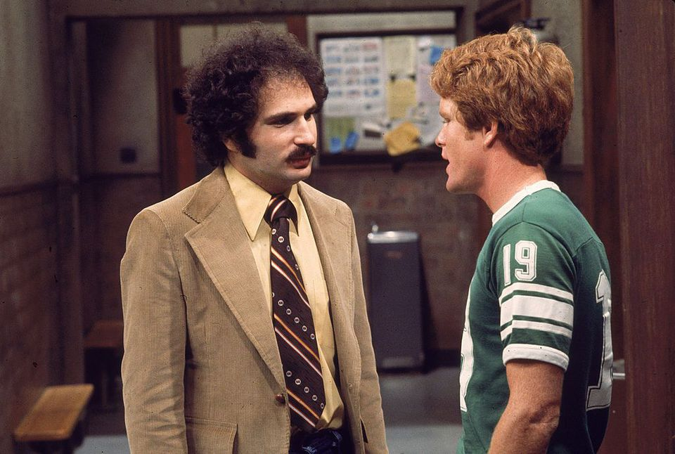 Actor Gabe Kaplan speaks to an unidentified actor in a still from the television series, 'Welcome Back Kotter,'