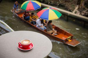 Cup of coffee near a Thai khlong