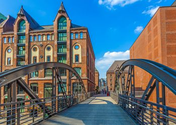 City of Warehouses or Speicherstadt district, Niederbaumbridge bridge and Kehrwiederspitze in Hamburg city