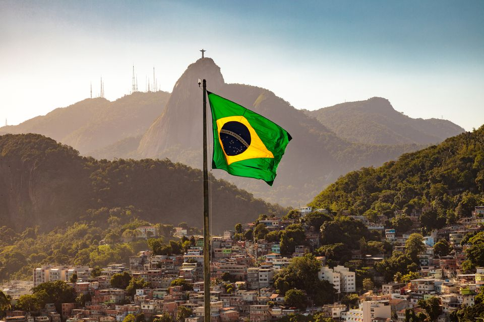 Brazilian flag waving with mountains in the background