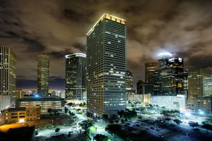 A haunting, misty view of the downtown Houston skyline at night