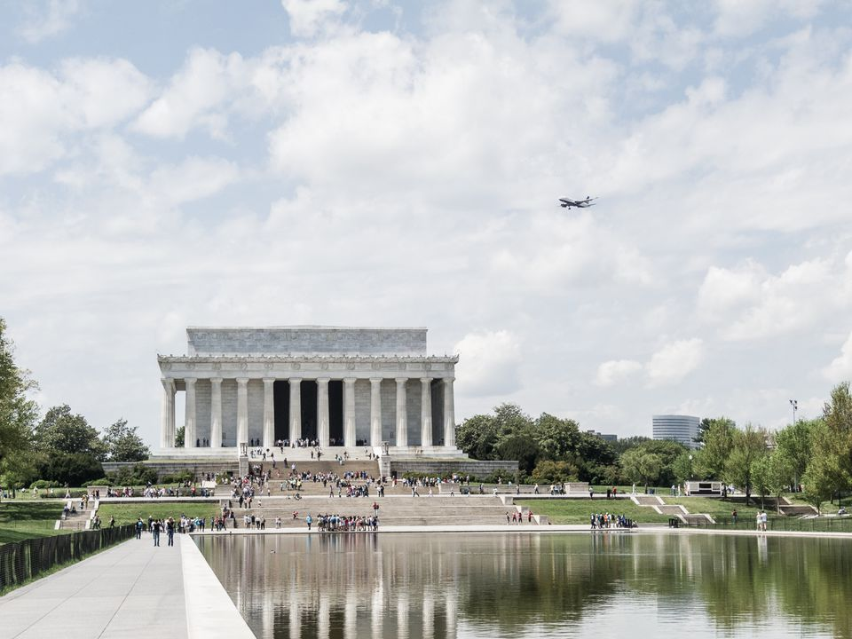 People At Lincoln Memorial Against Cloudy Sky