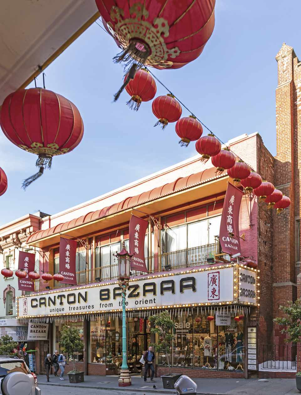 A general store with paper lanterns out front in Chinatown