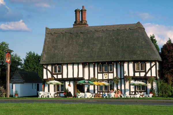 Half-timbered, thatched English country Pub, The Royal Oak in Cambridgeshire, England
