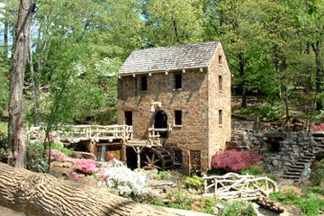 The manicured gardens surrounding the Old Mill at T.R. Pugh Memorial Park