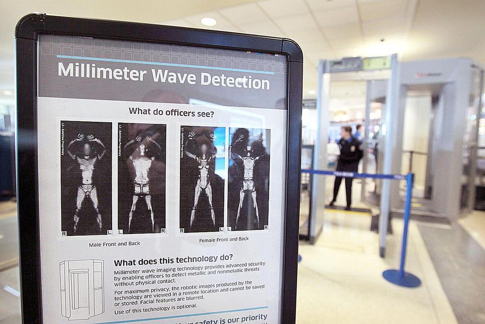 chicago il december 15 a sign informs travelers about millimeter wave detection technology