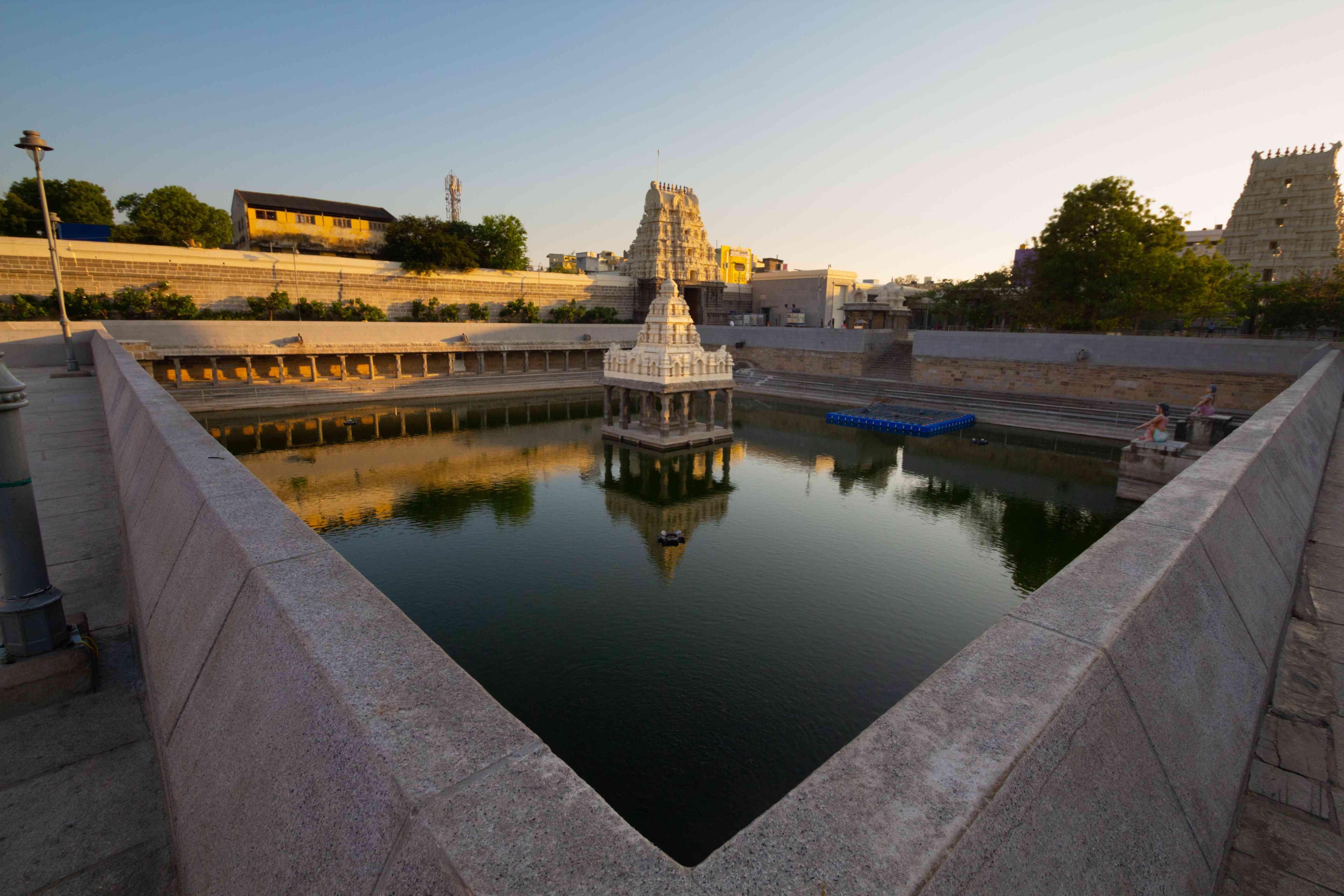 Kamakshi Amman Temple reflecting pool at sunset