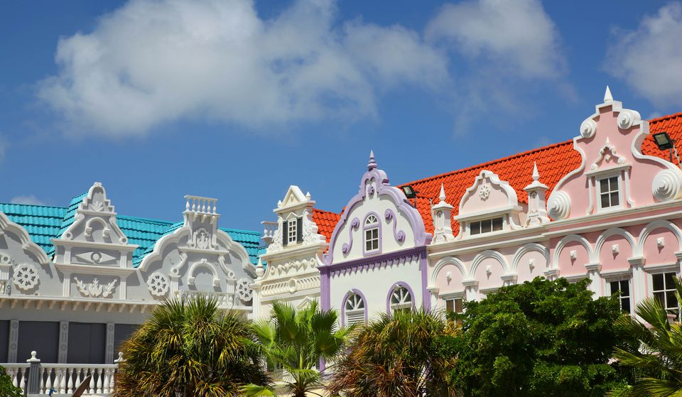 tops of pastel buildings with white decorative trim