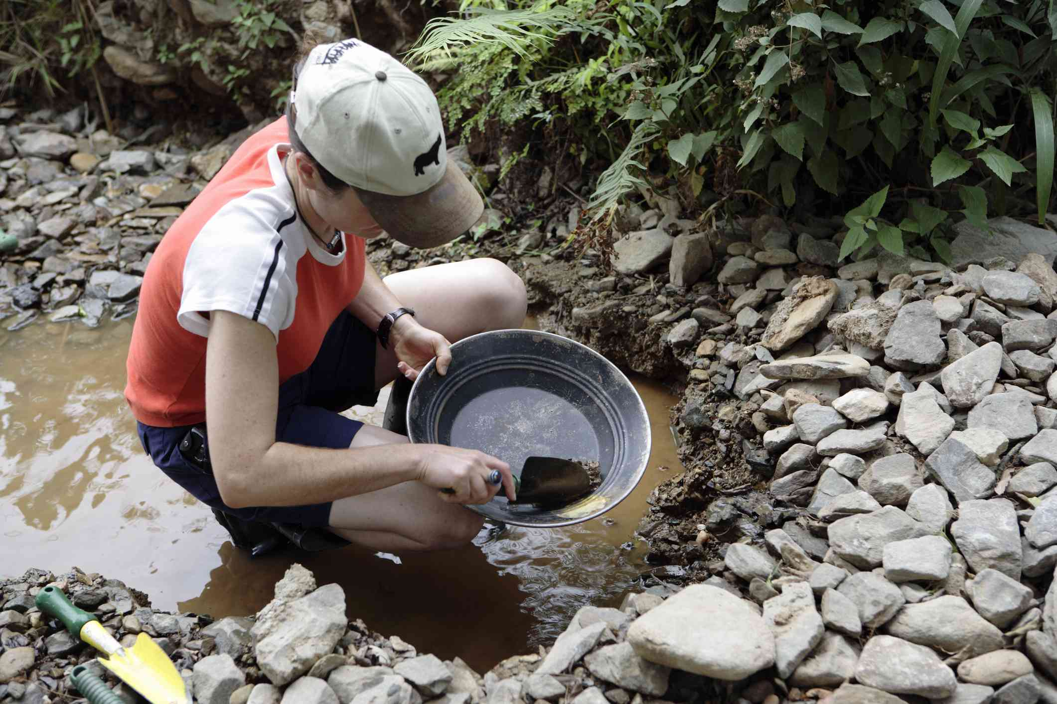 Woman panning for gold in Barberton, South Africa