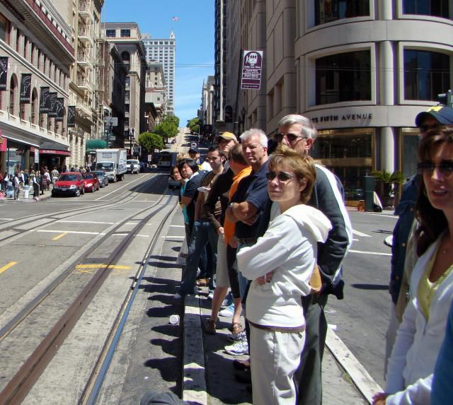 people waiting to board trolley in San Francisco