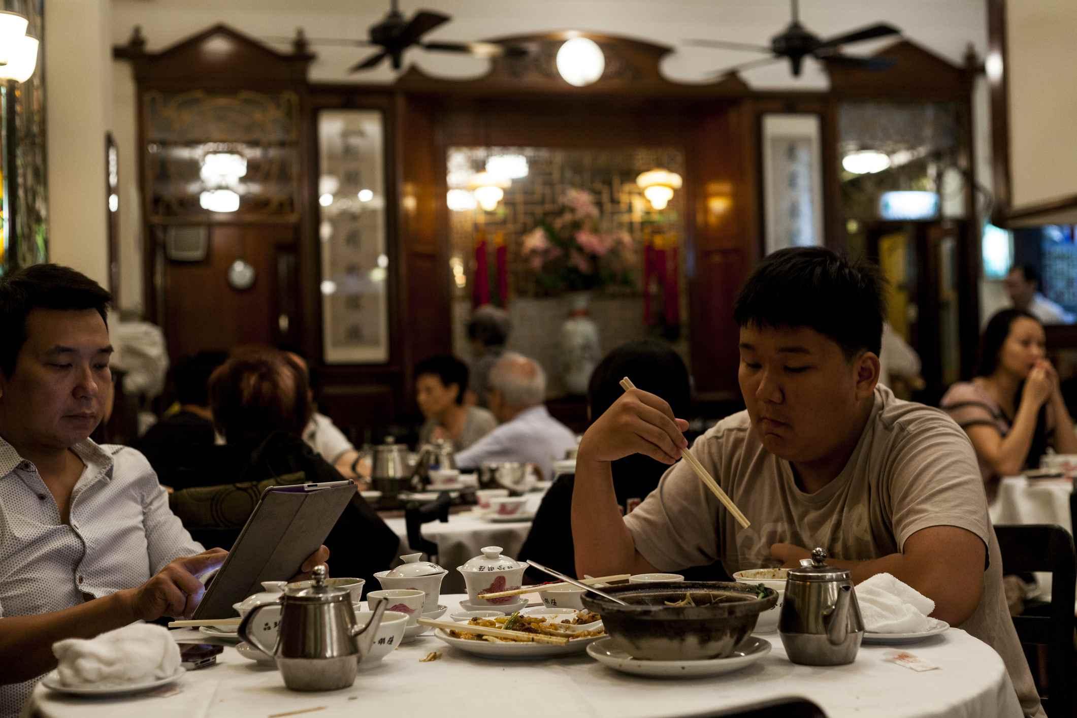 Diners at Luk Yu teahouse, Lan Kwai Fong