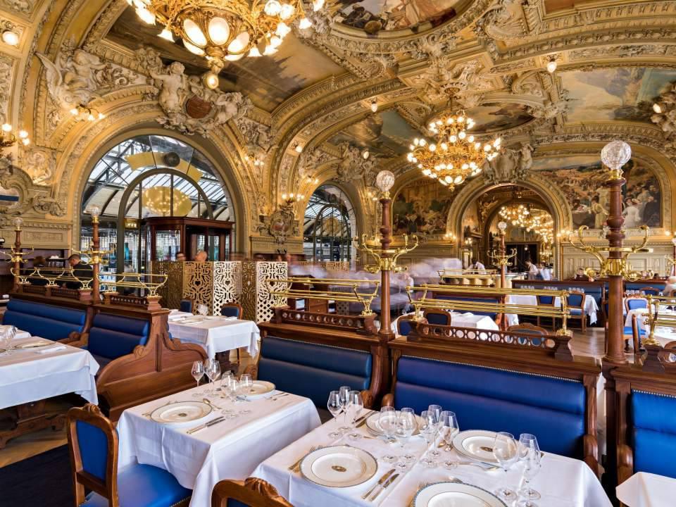 An old-world Parisian restaurant set for Christmas dinner